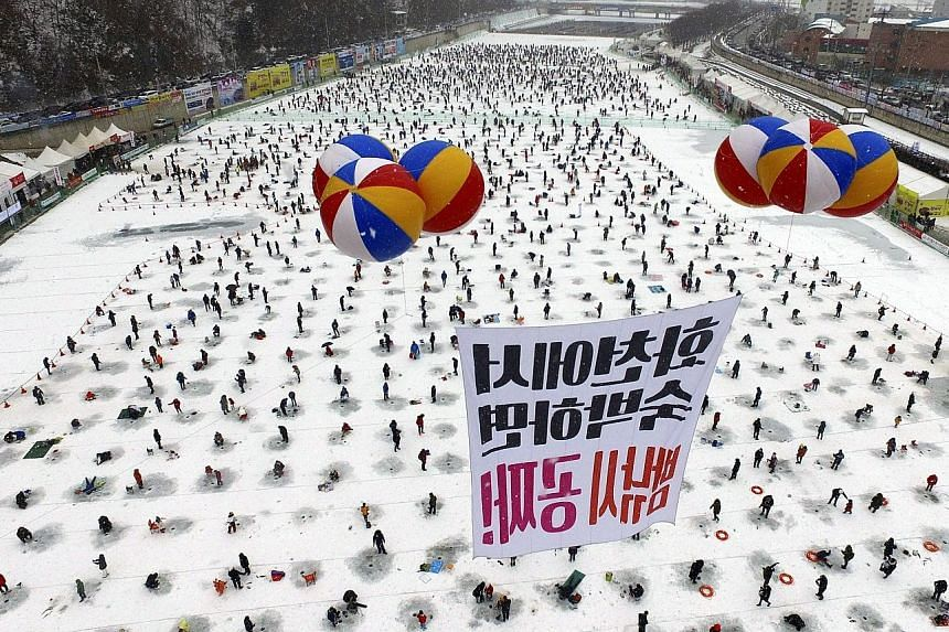 A frozen river in Hwacheon, 118km north-east of Seoul, South Korea, was packed yesterday as visitors fished for sancheoneo, a type of mountain trout. The Hwacheon Sancheoneo Ice Festival, which kicked off on Jan 14, will run until Feb 5. It saw its m