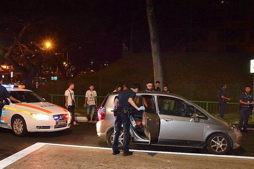 A police officer had to smash a window of the Honda Fit from Elitez Car Rental on Jan 13 because the driver was uncooperative. The male driver and his female passenger were later held for drug-related offences.