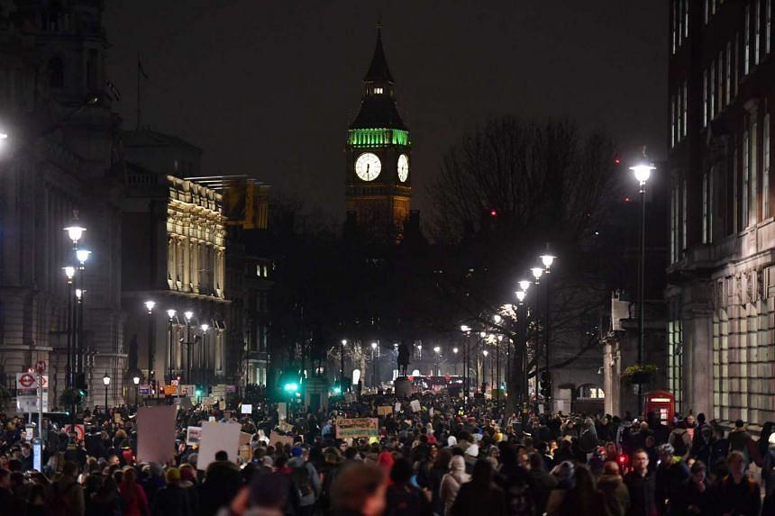 Demonstrators protest outside Downing Street against US President Donald Trump in central London on Jan 30. President Trump signed an executive order on Jan 27 restricting immigration from seven Muslim countries.