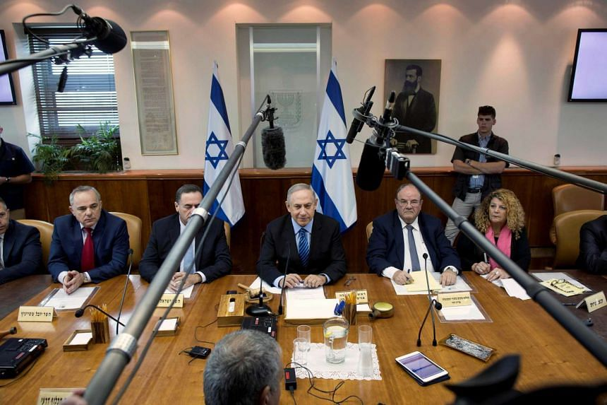 Israeli Prime Minister Benjamin Netanyahu (centre) has been harshly critical of the deal that six world powers including the United States under President Barack Obama struck with Iran to curb its nuclear programme in return for an end to multilater