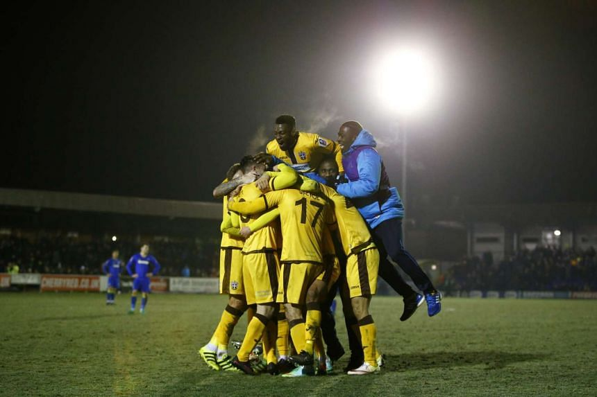 Sutton United players celebrate after the game with AFC Wimbledon on Jan 17.
