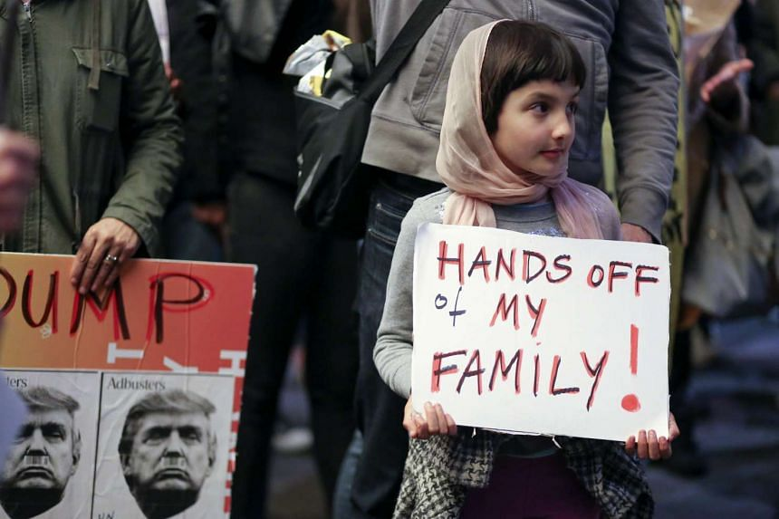 Rosalie Gurna, 9, joins hundreds of protesters denouncing the travel ban from Muslim-majority countries enacted by US President Donald Trump outside of the international terminal at Los Angeles International Airport on Jan 28. The executive order hal
