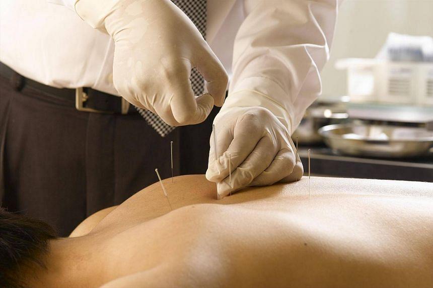 Acupuncture treatment for a patient.