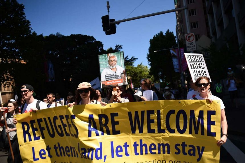 People marching in Sydney during an event organised by Doctors for Refugees to demand the humane treatment of asylum seekers and refugees.