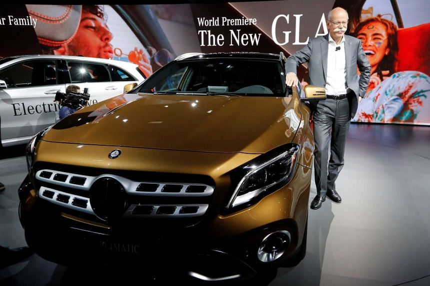 Dieter Zetsche poses in front of a Mercedes-Benz GLA 250 during the North American International Auto Show, Jan 8, 2017.