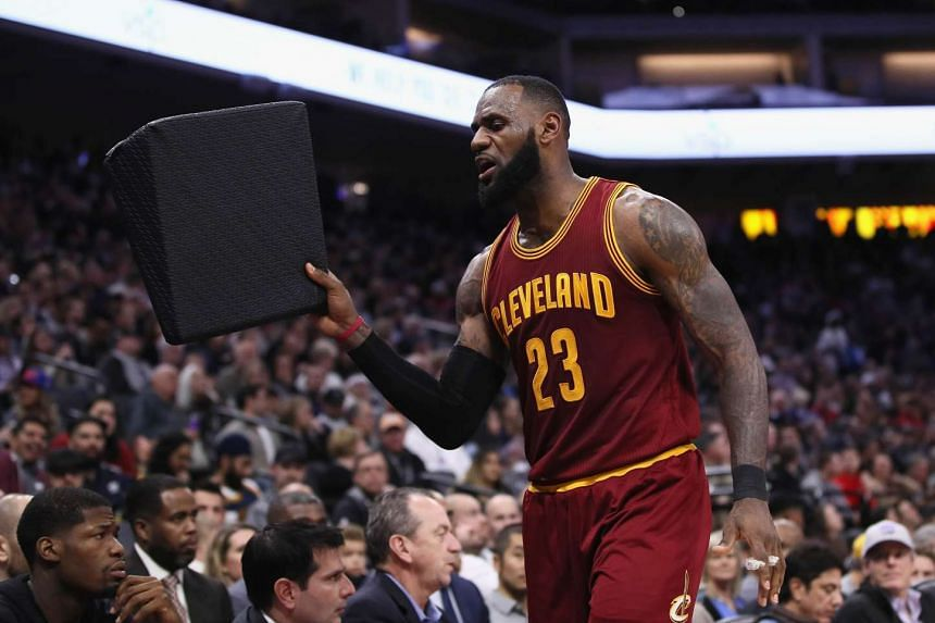 LeBron James #23 of the Cleveland Cavaliers reacts after being taken out of their game against the Sacramento Kings.