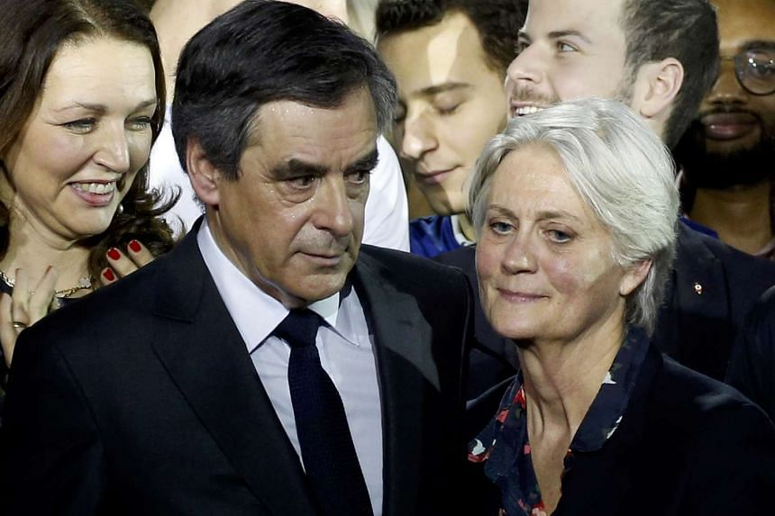 Francois Fillon and his wife, Penelope, at a political rally in Paris, France, Jan 29, 2017.