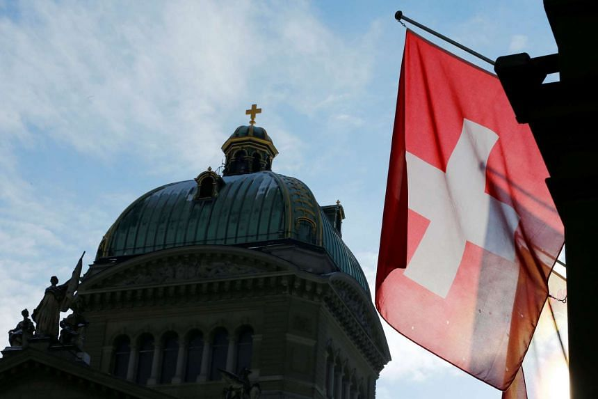 A Swiss flag is pictured in front of the Federal Palace in Bern, Switzerland, Jan 16, 2017.