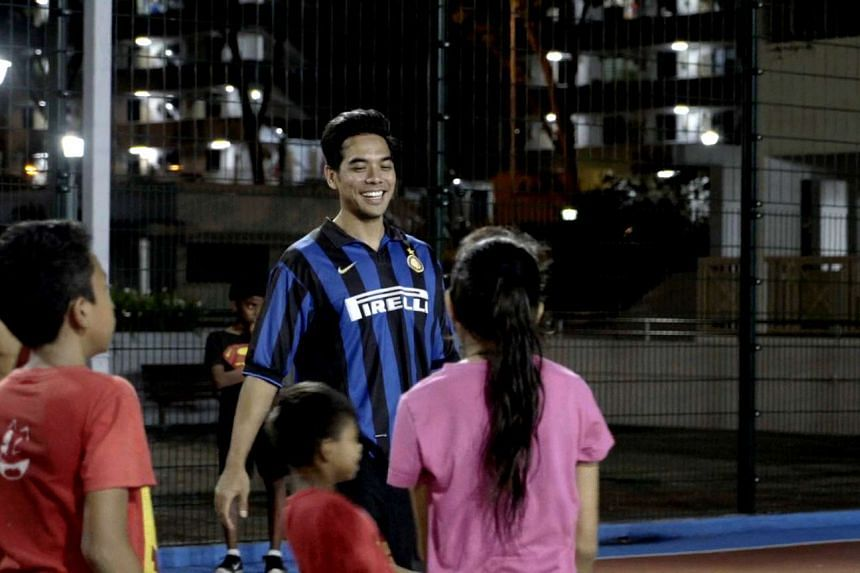 Screengrab showing Mr Irza Fauzan Suprapto conducting a football training session at a street soccer court in Jalan Kukoh as part of the Catch Plus after-school programme.