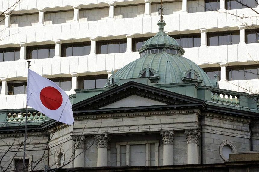 """The Bank of Japan hiked its economic growth forecasts, citing an improved global outlook and a weaker yen, but the country's finance chief warned of """"uncertainty"""" caused by US President Donald Trump's administration."""