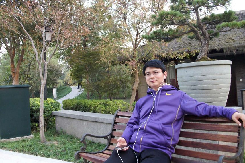Xiao Jianhua sits on a park bench in Beijing in an undated photo.