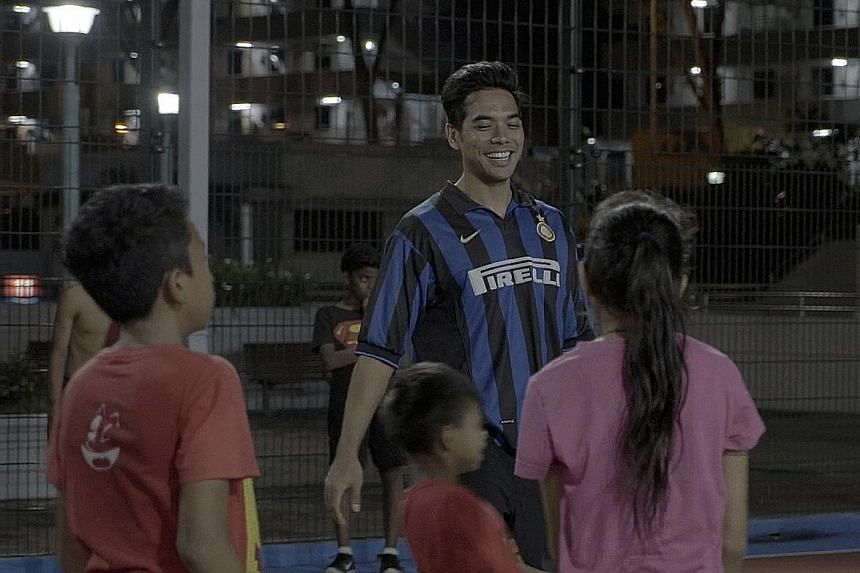 Mr Irza conducting a football training session at a street soccer court in Jalan Kukoh as part of the Catch Plus after-school programme. He hopes to ingrain the value of discipline in the children.