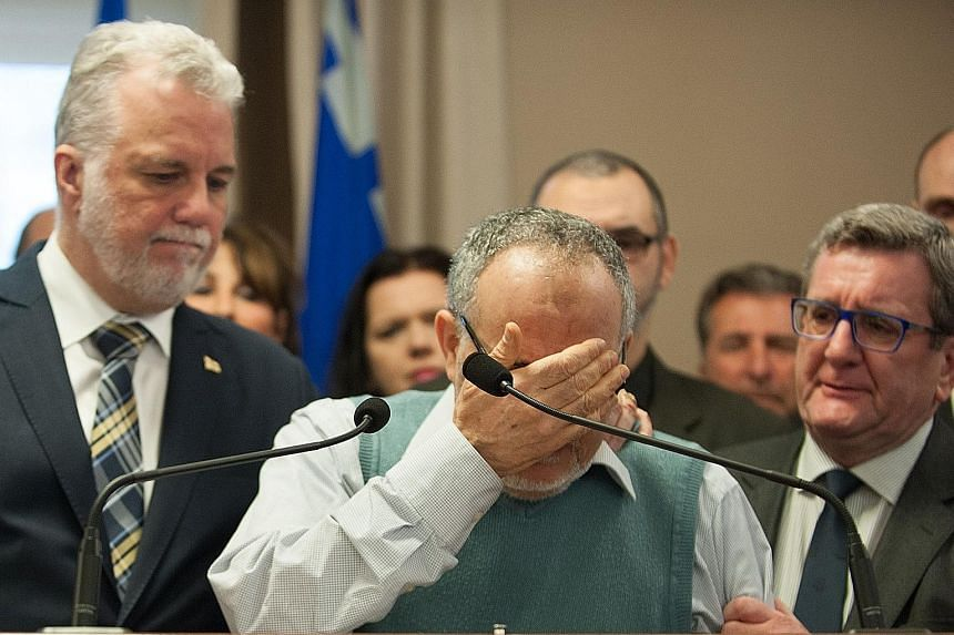 (From left) Quebec Premier Philippe Couillard, Mr Mohamed Labidi and Quebec City Mayor Regis Labeaume at a press conference held on Monday after the mosque shooting.