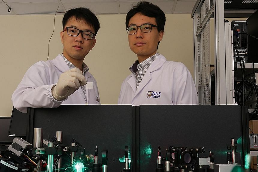 An NUS team, led by Dr Wu (left) and Prof Yang, has invented a cheap THz wave emitter after two years of research, potentially lowering costs in the field of terahertz technology.