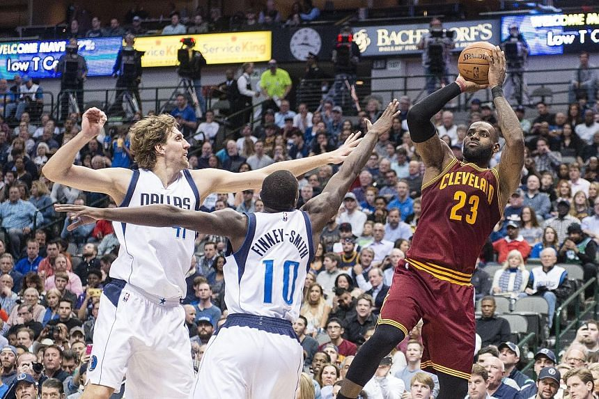 Cleveland Cavaliers forward LeBron James shooting over Dallas Mavericks forward Dirk Nowitzki (left) and Dorian Finney-Smith during the Cavs' unexpected 97-104 loss on Monday.