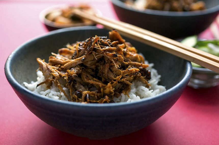 Shredded pork with gochujang barbecue sauce over rice.