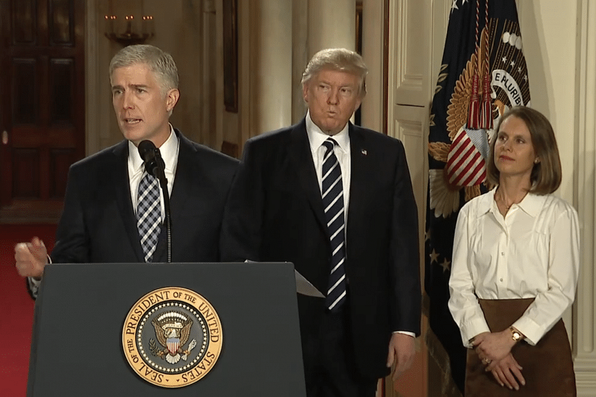 Screengrab of conservative US appeals court judge Neil Gorsuch (left), whom US President Donald Trump has nominated to fill a Supreme Court seat.