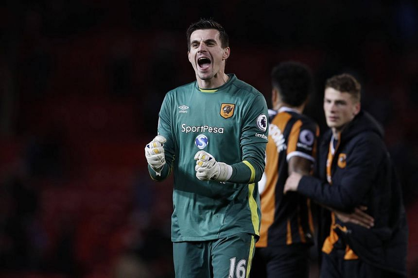 Hull City's Eldin Jakupovic celebrates after the game at Old Trafford on Wednesday (Feb 1).