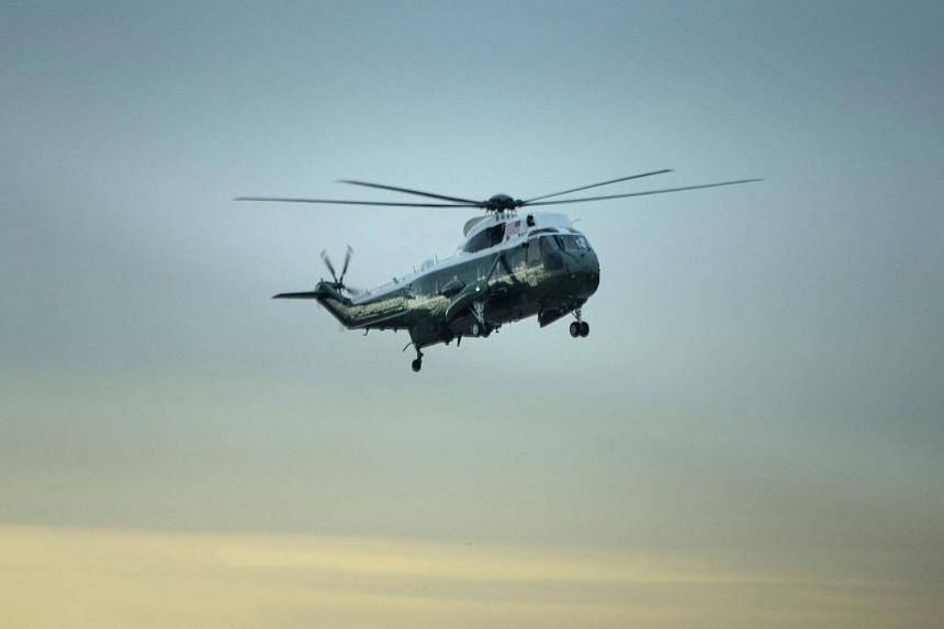 """Marine One with US President Donald Trump on board, lands at Dover Air Force Base on Feb 1, 2017, in Dover, Delaware, for the dignified transfer of Navy Seal Chief Petty Officer William """"Ryan"""" Owens, who was killed in Yemen on Jan 29."""