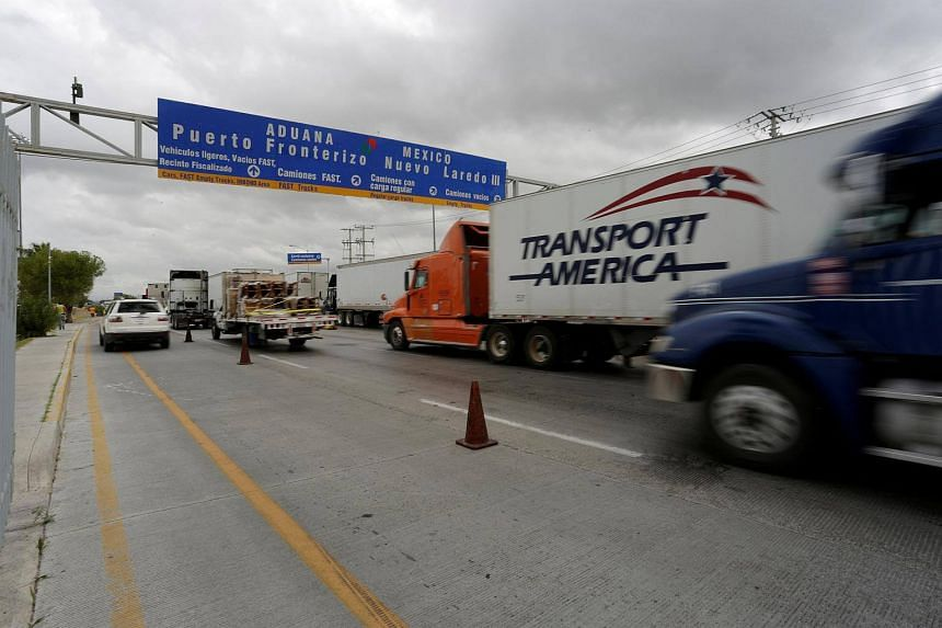 Trucks waiting in the queue for border customs control to cross into the US at the World Trade Bridge in Nuevo Laredo, Mexico, on Nov 2, 2016.