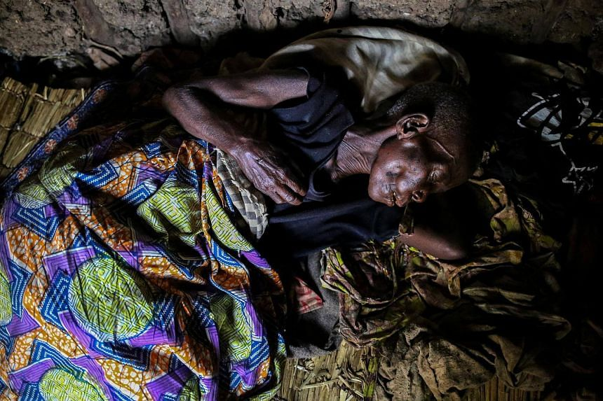 A woman, 60, who is suffering from malaria, resting in her house at Kagorwa Pygmy camp on Idjwi island in the Democratic Republic of Congo, on Nov 22, 2016.