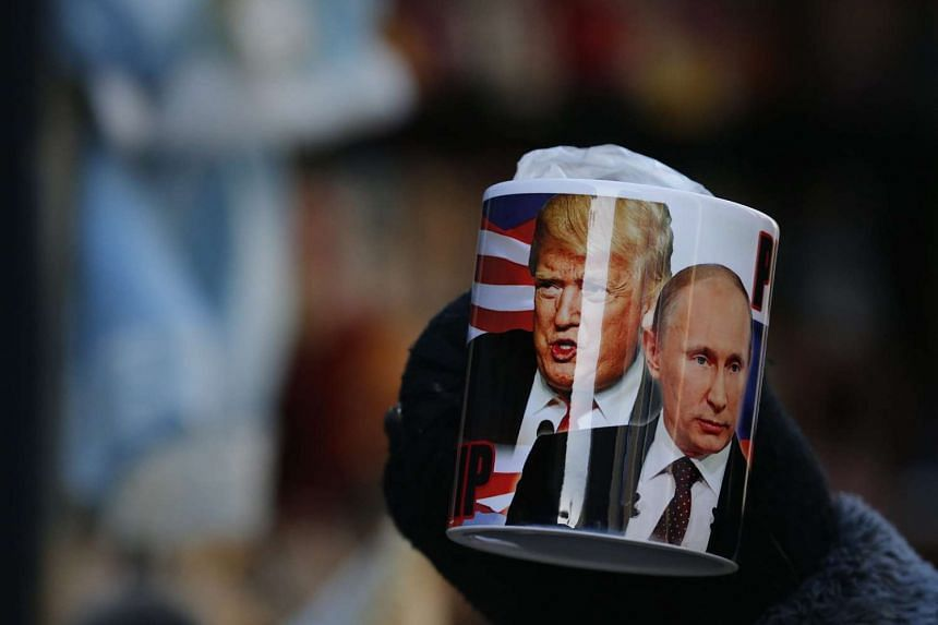 A mug showing the faces of US President Donald Trump and Russian President Vladimir Putin is seen at a souvenir stand in St Petersburg, Russia, on Jan 20, 2017.