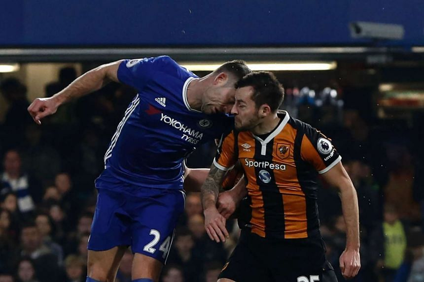 Chelsea's English defender Gary Cahill (left) and Hull City's English midfielder Ryan Mason clashing heads during the English Premier League football match between Chelsea and Hull City at Stamford Bridge in London on Jan 22, 2017.