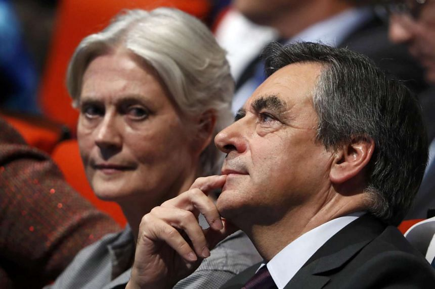 French politician Francois Fillon, member of the conservative Les Republicains political party and his wife Penelope (left) attend a final rally ahead of the first round of vote to choose the conservative candidate for France's presidential election