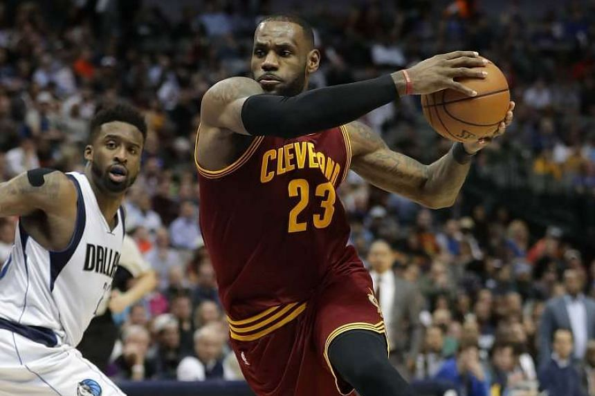 LeBron James (right) has not hesitated to make his feelings known about the state of the team's roster, openly questioning whether Cleveland are still as committed as they once were to bolster the talent around him after beating the Golden State Warr