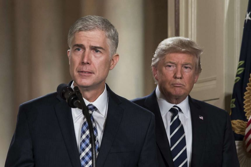 Neil Gorsuch (left), federal judge serving on the 10th US Circuit Court of Appeals, delivers remarks after US President Donald Trump announced him as his nominee for the Supreme Court.