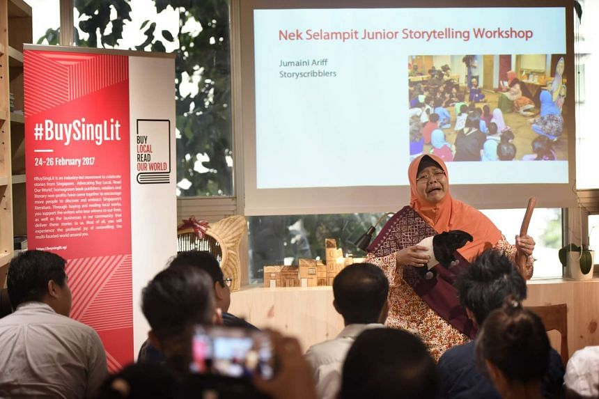 Author and storyteller Jumaini Ariff performing a snippet of a story at the media launch of #BuySingLit, at City Book Room on Feb 2, 2017.