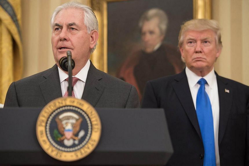 Rex Tillerson speaking after being sworn in as US Secretary of State as US President Donald Trump looks on in the Oval Office at the White House, on Feb 1, 2017.