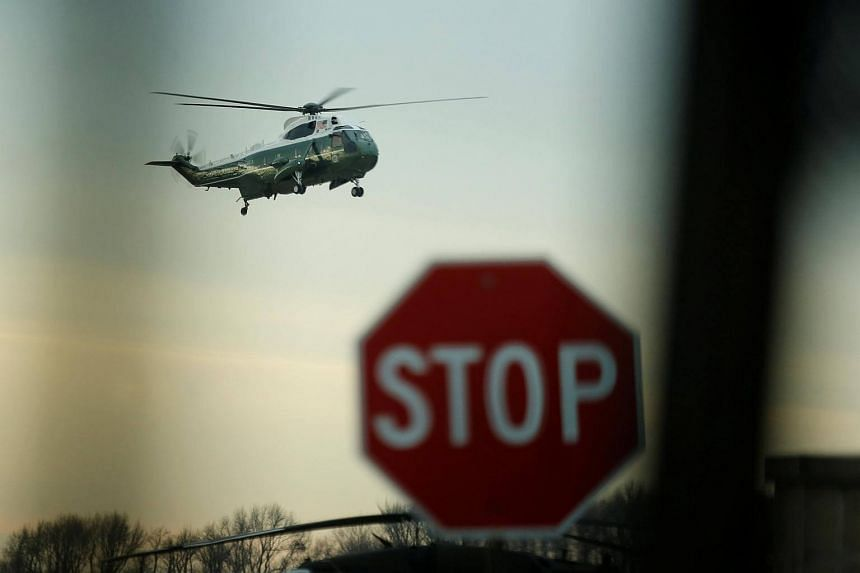 US President Donald Trump arriving aboard the Marine One to greet the remains of a US military commando killed during a raid on the al Qaeda militant group in southern Yemen on Sunday, at Dover Air Force Base, Dover, Delaware, US, on Feb 1, 2017.