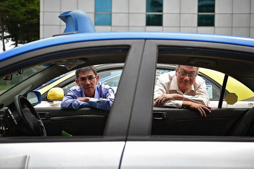 ComfortDelGro cabbies Tan Ah Suay (left) and Choo Joo Cheng have saved on their rentals under the 25CJ initiative by the taxi firm. Mr Tan, for instance, says he saves between $40 and $80 in rentals each week.