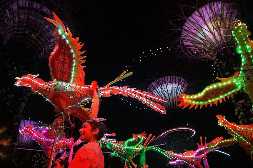 An all-female troupe from the Tian Eng Dragon and Lion Dance Centre brought to life handcrafted phoenixes with LED lights at Gardens by the Bay last night, in a performance sneak peek. The largest - at 11.16m in length and 5.05m in width - entered th