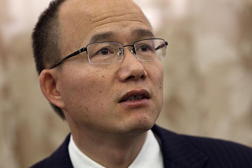 "(From left) Mr Zhou Chengjian, Mr Yim Fung, Mr Guo Guangchang and Mr Mao Xiaofeng are among the ""temporarily disappeared""."