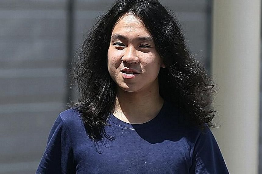 Loke (right) had grabbed Amos Yee's (above) hands and blocked the blogger's path using his body.