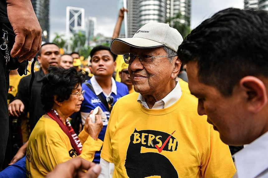 Former Malaysian prime minister and former Umno leader Dr Mahathir taking part in the Bersih 5 protest in Kuala Lumpur on Nov 19 demanding the resignation of Prime Minister Najib over an alleged corruption scandal.