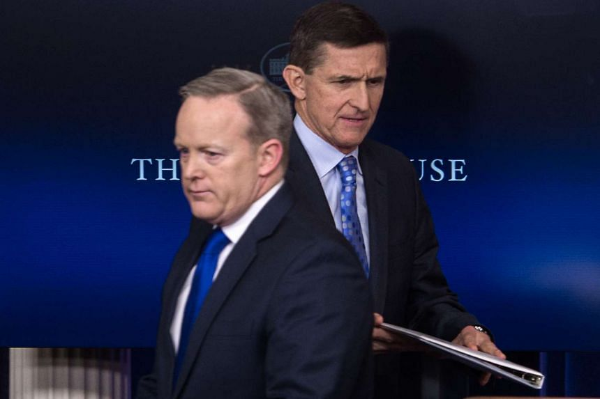US National Security Adviser Mike Flynn (right) walks past Press Secretary Sean Spicer as he makes his way to the lectern during the daily press briefing at the White House in Washington, DC, on Feb 1, 2017.