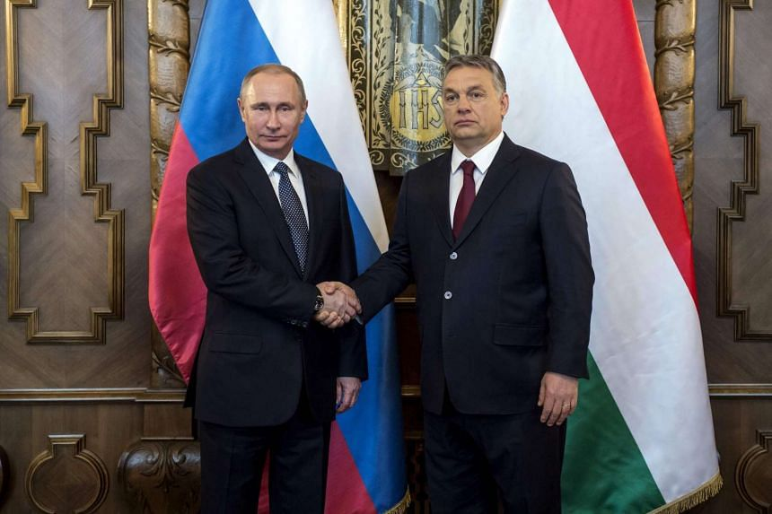 Russian President Vladimir Putin (left) is welcomed by his host Hungarian Prime Minister Viktor Orban (R) during his one-day visit, in the Hungarian parliament building of Budapest on Feb 2, 2017 prior to their official talks.