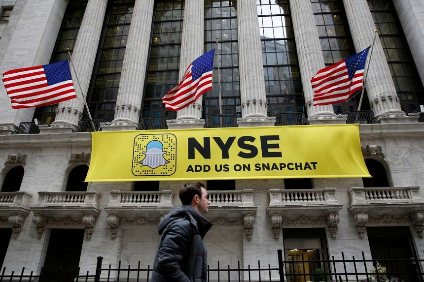 A Snapchat sign hangs on the facade of the New York Stock Exchange (NYSE) in New York City on Jan 23, 2017.