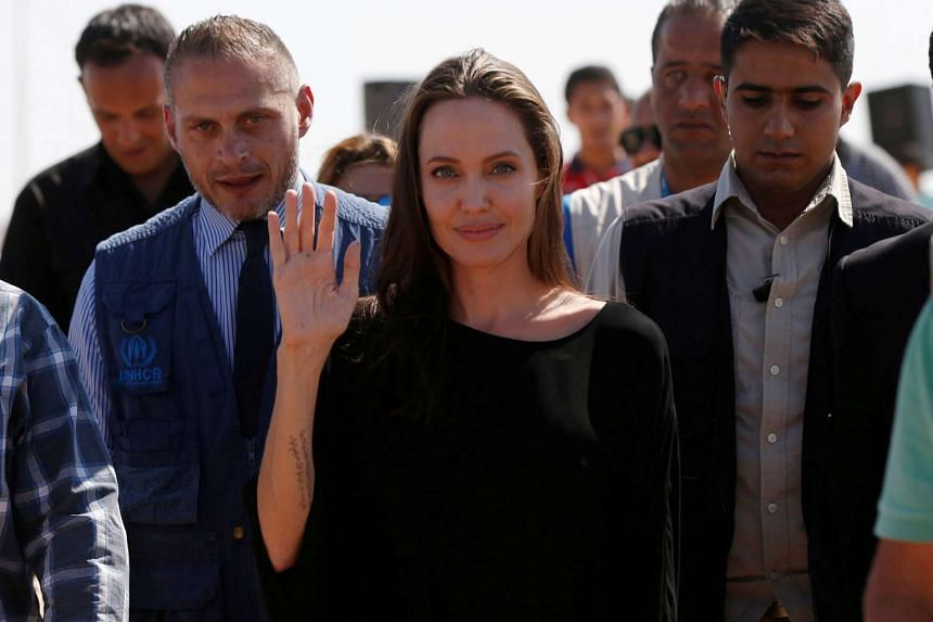 Angelina Jolie (centre) leaves after a news conference at the Azraq refugee camp for Syrians displaced by conflict, near Al Azraq city, Jordan on Sept 19, 2016.