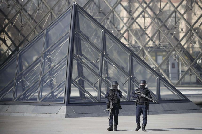 Police officers standing guard outside the Louvre in Paris, after an armed man was shot by a soldier while trying to rush into the museum, on Feb 3, 2017.