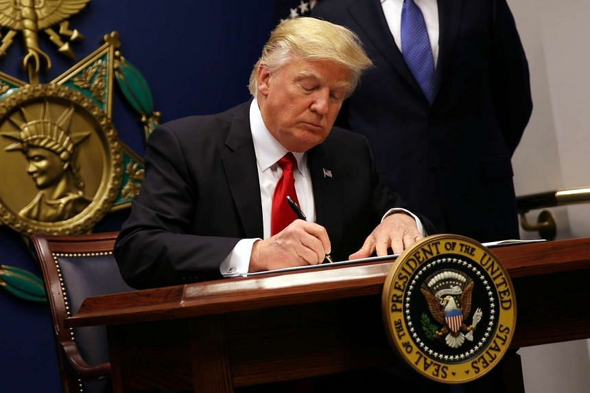 US President Donald Trump signs an executive order to impose tighter vetting of travelers entering the United States, at the Pentagon in Washington, US on Jan 27, 2017.