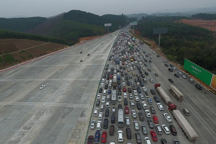 An aerial shot yesterday showing a massive jam on an expressway in Nanning as people travel out of Guangxi region to other parts of China in a reversal of the massive migration home for Chinese New Year. Yesterday also marked the end of the Spring Fe