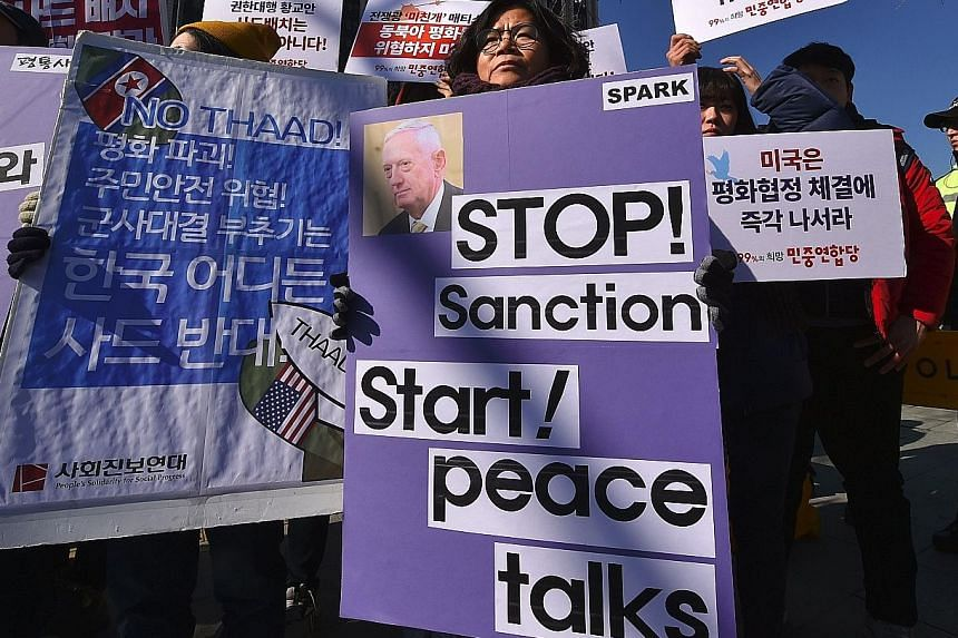 The US Defence Secretary's visit was met with anti-war activists' protests against the Thaad deployment and a pro-Trump rally by Christians.