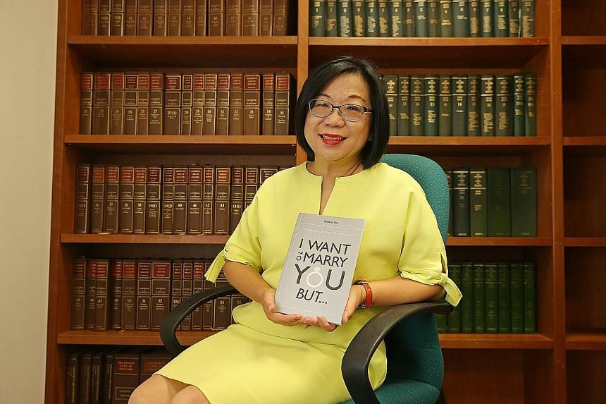 Mrs Jennifer Yeo, wife of former foreign minister George Yeo, with a copy of the book. It will be sold at major bookstores from Feb 20.