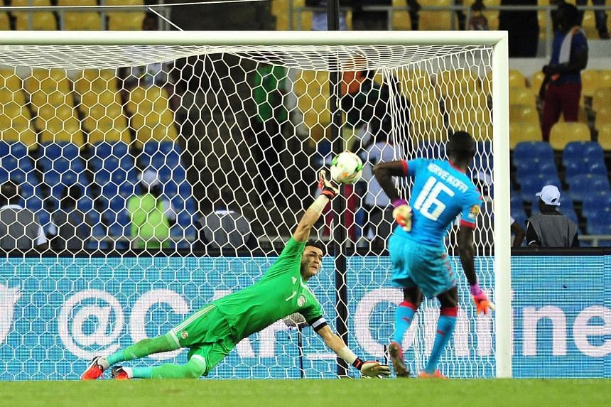 Essam El Hadary saving a penalty from Burkina Faso custodian Herve Koffi during the semi-final shoot-out in Libreville to keep Egypt alive. The 44-year-old then denied Bertrand Traore in the last kick to take his team to their ninth Africa Cup of Nat