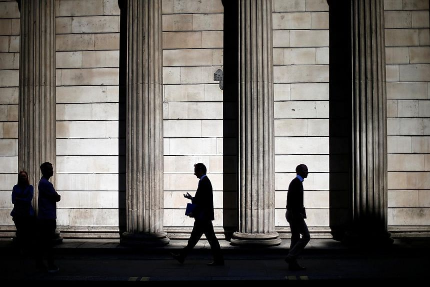 The Bank of England premises in the City of London. Despite upgrading its forecast for the economy, the BOE has left its key rate at a record-low 0.25 per cent.