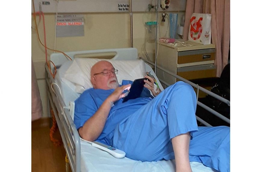 Mr Bernie Utchenik resting in the hospital after he suffered from a heart attack.